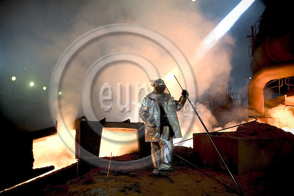 KATOWICE, POLAND 26.  AUGUST. 2005. . A worker walks infront of the blast furnace in the Nowa Huta steelworks. Photo: Uffe Noejgaard / EUP-IMAGES