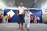 Two children take a bow after performing a short dance at a center for children affected by dioxin exposure in Da Nang, Vietnam. The Da Nang Association of Victims of Agent Orange/Dioxin says that more than 1,400 children around the city suffer from mental and physical disabilities because of dioxin exposure, a legacy of the U.S. military's use of Agent Orange and other herbicides during the Vietnam War more than 40 years ago. About 200 children attend three centers operated by the group, which aims to teach the children how to read and write, sew clothes, make handicrafts and eventually integrate into society. But most of them never will because of their disabilities, says Phanh Thanh Tien, the association's president. The Vietnam Red Cross estimates that 3 million Vietnamese suffer from illnesses related to dioxin exposure, including at least 150,000 people born with severe birth defects since the end of the war. The U.S. government is paying to clean up dioxin-contaminated soil at the Da Nang airport, which served as a major U.S. base during the conflict. But the U.S. government still denies that dioxin is to blame for widespread health problems in Vietnam and has never provided any money specifically to help the country's Agent Orange victims. May 28, 2012.