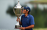 Pavit Tangkamolprasert of Thailand kisses the trophy as he celebrates his victory during the Venetian Macao Open 2016 at the Macau Golf and Country Club on 16 October 2016 in Macau, China. Photo by Marcio Machado / Power Sport Images