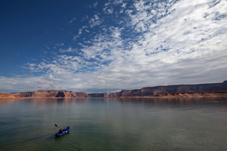 Nathaniel Sperry kayaks in West Canyon, Lake Powell, Glen Canyon National Recreation Area, Arizona, USA