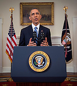 United States President Barack Obama makes a live statement to the nation concerning historic changes in U.S. relations with Cuba in the Cabinet Room of the White House in Washington, D.C. on Wednesday, December 17, 2014.  In his remarks the President announced he planned to start talks with Cuba to normalize ties and open an embassy as a result of the release of Alan Gross. <br /> Credit: Doug Mills / Pool via CNP