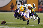 Green Bay Packers cornerback Tramon Williams levels a hit on Minnesota Vikings receiver Greg Lewis thus forcing an imcompletion during the second quarter of the game at the Hubert H. Humphrey Metrodome in Minneapolis, Minn. on Nov. 21, 2010.