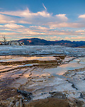 Yellowstone National Park, WY: Evening clouds reflecting in the thermal pools on the upper terraces of Mammoth Hot Springs