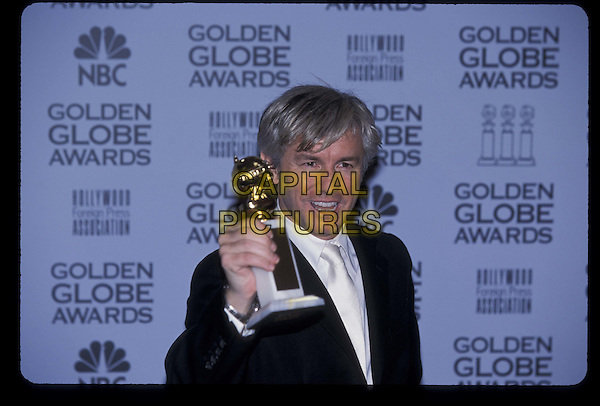 BAZ LUHRMAN.Golden Globes Awards.20 January 2002.Ref: 11372.half length, half-length, winner, trophy.*RAW SCAN- photo will be adjusted for publication*.www.capitalpictures.com.sales@capitalpictures.com.©Capital Pictures