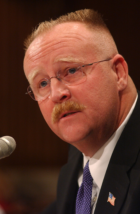 2FEMA101601 -- Joe Allaugh, director, Fedral Emergency Management Agency (FEMA), speaks at a hearing to review the agency's respanse to the Sept. 11, 2001 attacks.  Also in attendence were fire fighters from across the country.