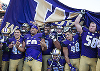 The Huskies celebrate their Apple Cup victory.