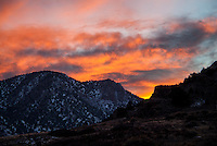A winter sunset fills the sky along the Arkansas River Canyon west of Cañon City, Colorado.