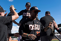 Oregon State Beavers center fielder Preston Jones (33) high fives teammates as he enters the dugout during a game against the Gonzaga Bulldogs on February 16, 2019 at Surprise Stadium in Surprise, Arizona. Oregon State defeated Gonzaga 9-3. (Zachary Lucy/Four Seam Images)