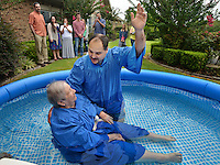 STAFF PHOTO BEN GOFF  @NWABenGoff -- 09/06/14 Victor Caballeros of Siloam Springs baptizes resident Mary Carte in a small pool following a worship service for residents and staff at Ashley Health & Rehabilitation Center in Rogers on Saturday September 6, 2014.