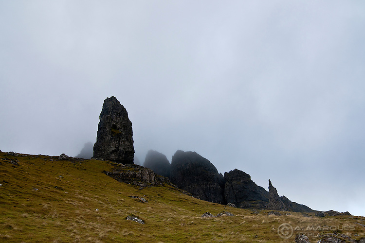 The Old Man of Storr and the Needle with Quiraing enshrouded in fog, Isle of Skye, Scotland. .Image from the hiking trail to the top.