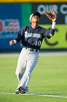 Pulaski Mariners left fielder Jesus Ugueto (40) tracks a fly ball during the Appalachian League game against the Burlington Royals at Burlington Athletic Park on June20 2013 in Burlington, North Carolina.  The Royals defeated the Mariners 2-1 in 13 innings.  (Brian Westerholt/Four Seam Images)