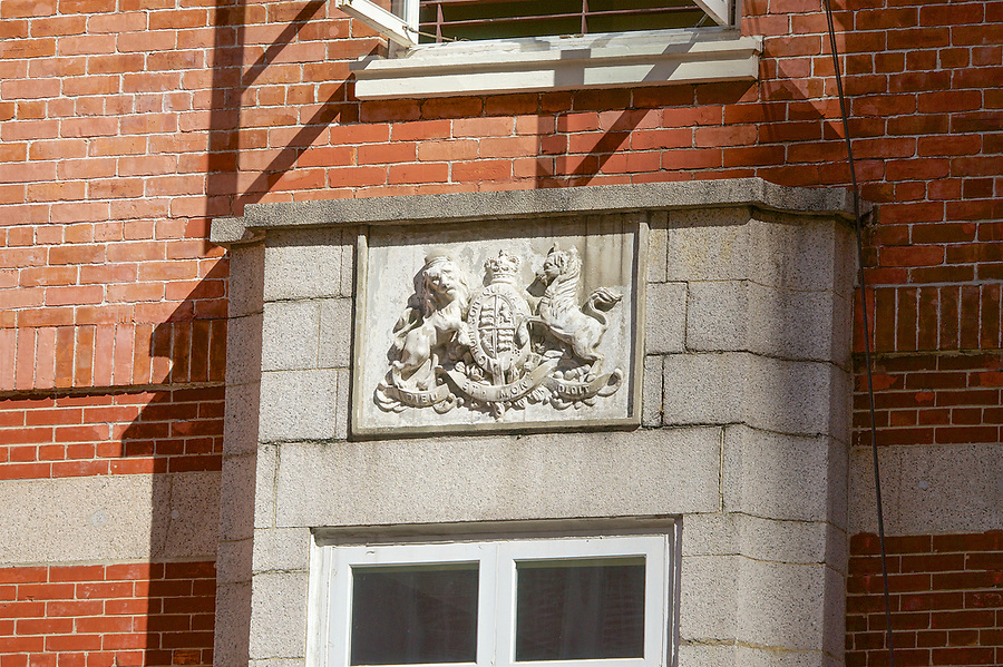 The coat of arms above the entrance to King's College.