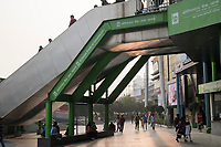 People walk along the sidewalk and overpasses at HUDA City Centre in Gurugram, Haryana, India, on Mon., December 10, 2018.