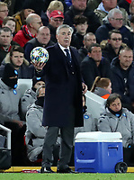27th November 2019; Anfield, Liverpool, Merseyside, England; UEFA Champions League Football, Liverpool versus SSC Napoli ; SSC Napoli manager Carlo Ancelotti collects the ball after it lands in the away team dugout - Editorial Use