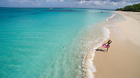Young woman enjoying a day on the beach<br /> Buck Island National Monument<br /> St. Croix<br /> US Virgin Islands