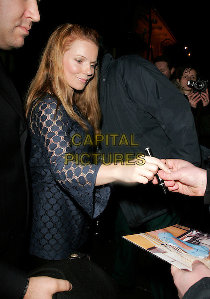 GERI HALLIWELL.Finch & Partners' Pre-BAFTA Party, Annabel's, Berkely Sqaure, London, UK..February 10th, 2007.half length blue sheer polka dot dress signing autograph fans crowd.CAP/AH.©Adam Houghton/Capital Pictures