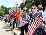 Waterloo residents lined up in front of Waterloo City Hall and waited for the procession. Dozens of police departments joined in the procession from St. Louis to Waterloo for slain Illinois State Police Trooper Nick Hopkins on Monday August 26, 2019. <br /> Photo by Tim Vizer