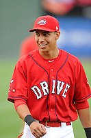 Designated hitter Mauricio Dubon (10) of the Greenville Drive is pictured before a game against the Augusta GreenJackets on Thursday, June 11, 2015, at Fluor Field at the West End in Greenville, South Carolina. Dubon is the No. 23 prospect of the Boston Red Sox, according to Baseball America. Greenville won, 10-1. (Tom Priddy/Four Seam Images)