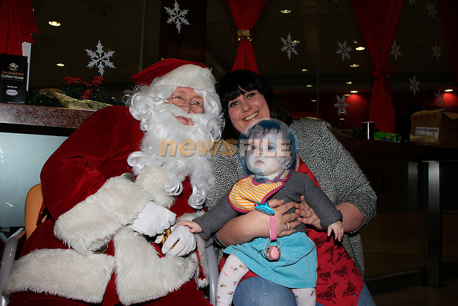 Santa with Eleanor O'Brian &amp; Lucy Dhomps during his visit to Mumstown in the Bagel bar, Laurence Centre on Tuesday 2nd December 2014.<br /> Picture:  Thos Caffrey / www.newsfile.ie