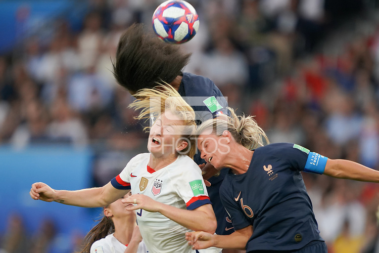 PARIS, FRANCE - JUNE 28: Samantha Mewis #3, Wendie Renard #3, Amandine Henry #6 during a 2019 FIFA Women's World Cup France quarter-final match between France and the United States at Parc des Princes on June 28, 2019 in Paris, France.