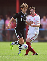 Lincoln City's Alex Woodyard vies for possession with Lincoln United's Conner Robinson<br /> <br /> Photographer Chris Vaughan/CameraSport<br /> <br /> Football - Pre-Season Friendly - Lincoln United v Lincoln City - Saturday 8th July 2017 - Sun Hat Villas Stadium - Lincoln<br /> <br /> World Copyright &copy; 2017 CameraSport. All rights reserved. 43 Linden Ave. Countesthorpe. Leicester. England. LE8 5PG - Tel: +44 (0) 116 277 4147 - admin@camerasport.com - www.camerasport.com