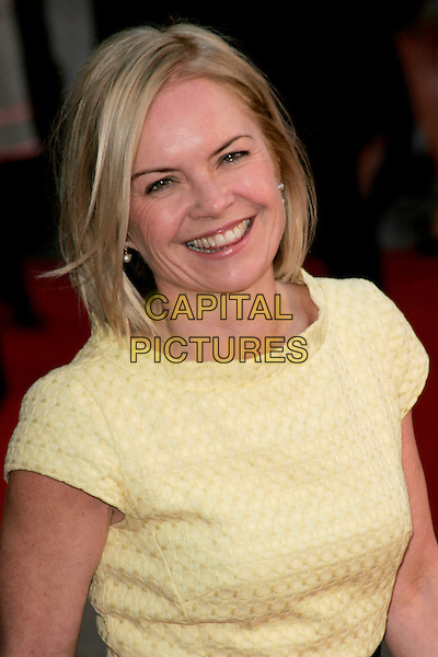 "MARIELLA FROSTRUP.The ""Leatherheads"" European Film Premiere held at the Odeon cinema, Leicester Square London, England..April 8th, 2008.headshot portrait yellow.CAP/AH.©Adam Houghton/Capital Pictures."
