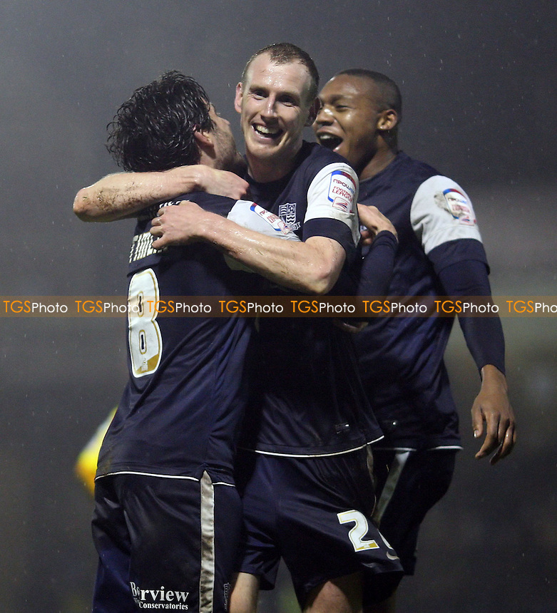 Marc Laird scores the 3rd goal for Southend and celebrates with Michael Timlin and Britt Assombalonga - Southend United vs Rochdale, League 2 at Roots Hall, Southend - 24/11/12 - MANDATORY CREDIT: Rob Newell/TGSPHOTO - Self billing applies where appropriate - 0845 094 6026 - contact@tgsphoto.co.uk - NO UNPAID USE.