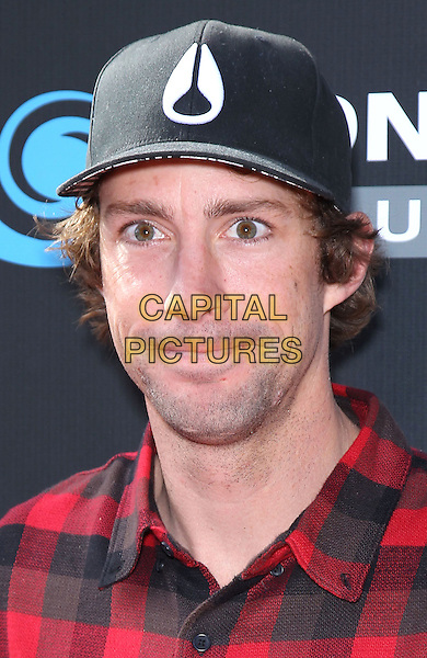 Travis Pastrana.Tony Hawk's 3rd Annual Stand Up For Skateparks fundraiser at Red Rock Station Hotel and Casino, Las Vegas, Nevada, USA.  .November 5th, 2011.headshot portrait black baseball cap hat red check .CAP/ADM/MJT.© MJT/AdMedia/Capital Pictures.