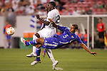 11 March 2008: Yendry Diaz (CUB) (5) challenges Jozy Altidore (USA) (12) for the ball. The United States U-23 Men's National Team tied the Cuba U-23 Men's National Team 1-1 at Raymond James Stadium in Tampa, FL in a Group A game during the 2008 CONCACAF's Men's Olympic Qualifying Tournament.