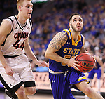 SIOUX FALLS, SD: MARCH 7: Michael Orris #50 of South Dakota State drives past Mitch Hahn #44 of Omaha during the Men's Summit League Basketball Championship Game on March 7, 2017 at the Denny Sanford Premier Center in Sioux Falls, SD. (Photo by Dick Carlson/Inertia)