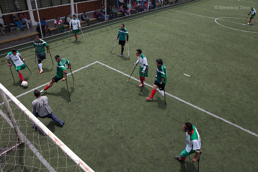 "Jorge Morales Gil (R), a player from Guerreros Aztecas, lines up a shot on an open goal during a game with the team in Mexico City, Mexico on September 13, 2014. Jorge, 17, lost his right leg when he was 14 after falling out of a bus. He is a student. Guerreros Aztecas (""Aztec Warriors"") is Mexico City's first amputee football team. Founded in July 2013 by five volunteers, they now have 23 players, seven of them have made the national team's shortlist to represent Mexico at this year's Amputee Soccer World Cup in Sinaloa this December. The team trains twice a week for weekend games with other teams. No prostheses are used, so field players missing a lower extremity can only play using crutches. Those missing an upper extremity play as goalkeepers. The teams play six per side with unlimited substitutions. Each half lasts 25 minutes. The causes of the amputations range from accidents to medical interventions – none of which have stopped the Guerreros Aztecas from continuing to play. The players' age, backgrounds and professions cover the full sweep of Mexican society, and they are united by the will to keep their heads held high in a country where discrimination against the disabled remains widespread. (Photo by Bénédicte Desrus)"