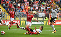 20170803 - BREDA , NETHERLANDS : Danish Pernille Harder (10) with Austrian Laura Feiersinger (down) and Carina Wenninger (R)  pictured during the female soccer game between Denmark and Austria  , the semi final at the Women's Euro 2017 , European Championship in The Netherlands 2017 , Thursday 3th of August 2017 at Stadion Rat Verlegh in Breda , The Netherlands PHOTO SPORTPIX.BE | DIRK VUYLSTEKE