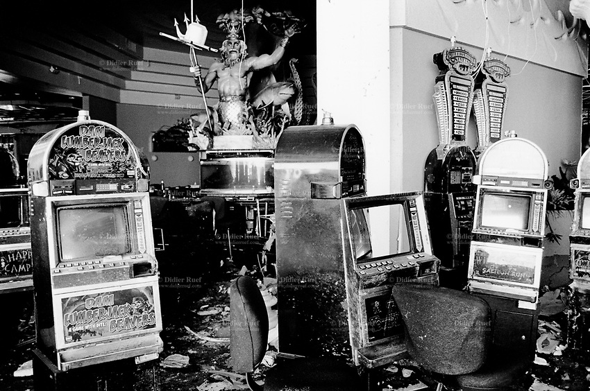 USA. Mississippi. Gulfport. Aftermath of hurricane Katrina. Copa Casino. Due to massive floating  of the tidal surge (water wave), casinos barges are destroyed or hurled hundred of feet away from their anchorage points. Slot machines, chairs and gaming tables are all destroyed. A statue of the greek god Poseidon with a shark. © 2005 Didier Ruef