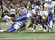 Annapolis, MD - October 7, 2017: Navy Midshipmen fullback Chris High (33) gets tackled during the game between Air Force and Navy at  Navy-Marine Corps Memorial Stadium in Annapolis, MD.   (Photo by Elliott Brown/Media Images International)