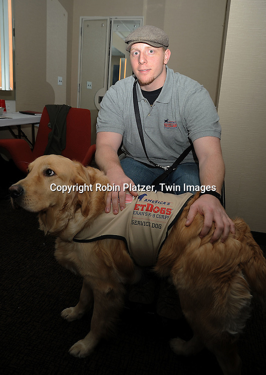 Navy Corpsman HM3 Joseph Worley and his service dog Benjamin..at The WaMu Theatre at Madison Square Garden on February 21, 2009 in New York City. Griffin is dedicating her New York performances to America's VetDogs, her favorite charity. VetDogs trains and provides assistance dogs to disabled veterans of all eras and has provided the first-ever combat stress relief dogs to be deployed in Iraq. ....Robin Platzer, Twin Images