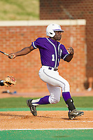 Josh Greene (1) of the High Point Panthers follows through on his swing against the Coastal Carolina Chanticleers at Willard Stadium on March 15, 2014 in High Point, North Carolina.  The Chanticleers defeated the Panthers 1-0 in the first game of a double-header.  (Brian Westerholt/Four Seam Images)