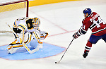 24 September 2009: Boston Bruins' goaltender Tim Thomas stops Montreal Canadiens center Tomas Plekanec in a shootout at the Bell Centre in Montreal, Quebec, Canada. The Bruins edged out the Canadiens in the overtime shootout 2-1 in their pre-season matchup. Mandatory Credit: Ed Wolfstein Photo