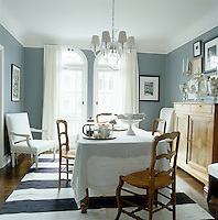 The antique sideboard, table and chairs lend a distinctly French feel to the dining room