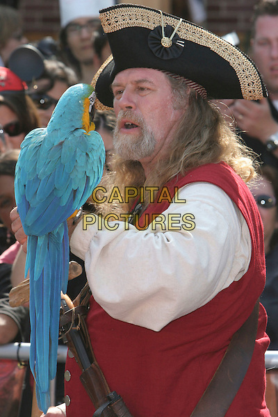"""ATMOSPHERE.""""Pirates Of The Caribbean: At World's End"""" World Premiere held at Disneyland, Anaheim, California, USA,.19 May 2007..half length dressed-up costume parrot hat bird.CAP/ADM/CH.©Charles Harris/AdMedia/Capital Pictures."""