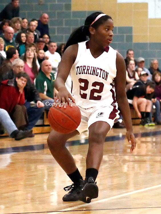 Waterbury, CT-  February 2013-021913CM07-  Torrington's Mika Howard helps lead her team to the NVL championship at Kennedy High School in Waterbury Tuesday night.   Torrington defeated Holy Cross, 40-34.     Christopher Massa Republican-American