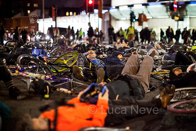 London, 27/11/2015. This evening, hundreds of cyclists held a demonstration outside the TFL (Transport for London) HQ blocking the Blackfriars road in protest at dangerous traffic conditions. The demonstration ended with a 15-minute &quot;die-in&quot;, where protesters laid on the road with their bicycles. From the organiser Facebook page: &lt;&lt;This is Stop Killing Cyclists third annual major November protest, following the first mass die-in outside Transport for London's HQ on Blackfriar's Road in November 2013, after the terrible spate of 6 cyclists being killed within a month. This &quot;No More Coffins Die-In &amp; Vigil&quot;, as well as our usual die-in, will involve the placing of symbolic coffins marking each of the currently 21 cyclists killed on London's roads, since the November 2013 Die-In, in front of the TfL HQ [&hellip;]&gt;&gt;. Cyclists and pedestrians are increasingly distressed at the number of larger vehicles (including buses, trucks and lorries) with blind spots driving on inner city roads which are responsible for the majority of deaths. <br /> <br /> For more information please click here: http://on.fb.me/1TiiV3k &amp; http://bit.ly/1RbvOgD