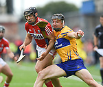 Christopher Joyce of Cork in action against John Conlon of Clare during their Munster senior hurling final at Thurles. Photograph by John Kelly.