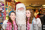 Pictured with Santa at CH Chemist Christmas discount evening on Friday night werel-r: (Amy Lawlor) (Tralee) and Kia O'Gorman (Tralee)..