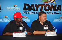 Jul. 3, 2008; Daytona Beach, FL, USA; New England Patriots wide receiver Randy Moss (left) announces his co-ownership with David Dollar of a NASCAR Craftsman Truck Series team prior to practice for the Coke Zero 400 at Daytona International Speedway. Mandatory Credit: Mark J. Rebilas-