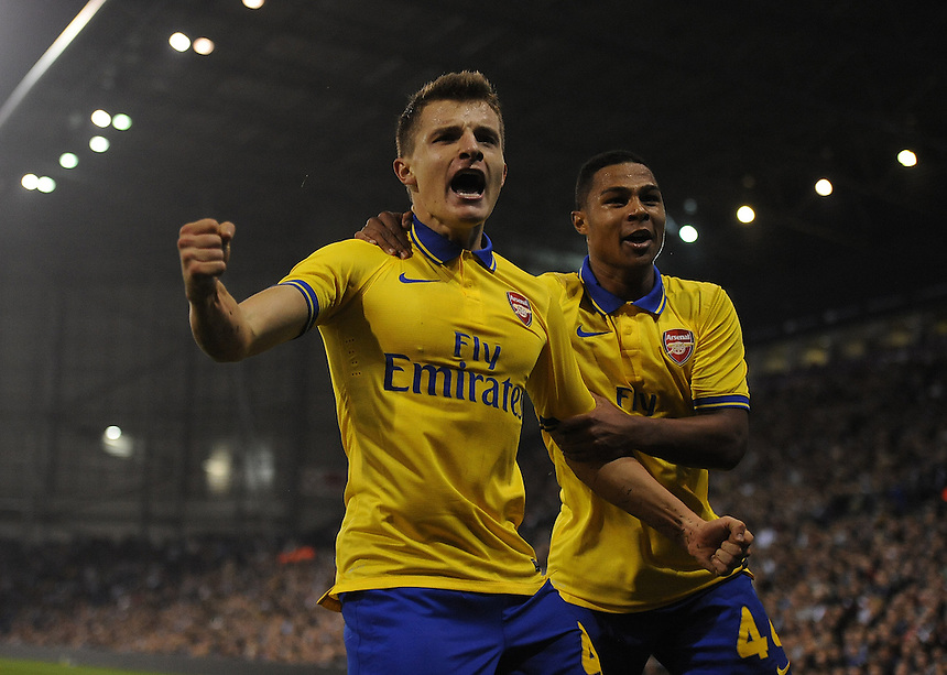 Arsenal's Thomas Eisfeld celebrates scoring the opening goal with team-mate Serge Gnabry<br /> <br /> Photo by Stephen White/CameraSport<br /> <br /> Football - Capital One Cup Third Round - West Bromwich Albion v Arsenal - Wednesday 25th September 2013 - The Hawthorns - West Bromwich<br />  <br /> &copy; CameraSport - 43 Linden Ave. Countesthorpe. Leicester. England. LE8 5PG - Tel: +44 (0) 116 277 4147 - admin@camerasport.com - www.camerasport.com