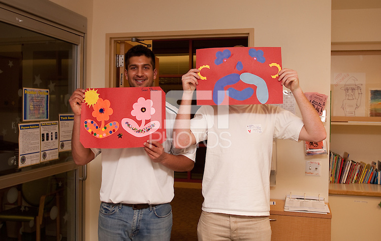 PALO ALTO, CA -- January 28, 2012: Sahil Bloom and istian Griffith during a visit to Lucile Packard Children's Hospital Thursday night in Palo Alto by members of the Stanford baseball team.