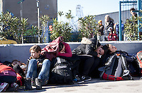 Pictured: Female migrants and children gather at the port Monday 22 February 2016<br /> Re: Thousands of migrants, most from Syria, have landed to the port of Pireaus, after crossing the border from Turkey to various islands like Lesvos and Kos in Greece.