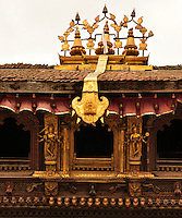 A maginificent piece of architecural art in the heritage temple complex of Nepa ina and around Kathmandu. The handcrafted wood sculptures and carvings on the doors, windows and balustrades are unique to Nepali cultural art. The golden panel is used to announce the fact that a living goddess resides here.