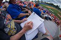 A fan keeps score during the game between the Wake Forest Demon Deacons and the Florida Gators in Game Two of the Gainesville Super Regional of the 2017 College World Series at Alfred McKethan Stadium at Perry Field on June 11, 2017 in Gainesville, Florida.  (Brian Westerholt/Four Seam Images)