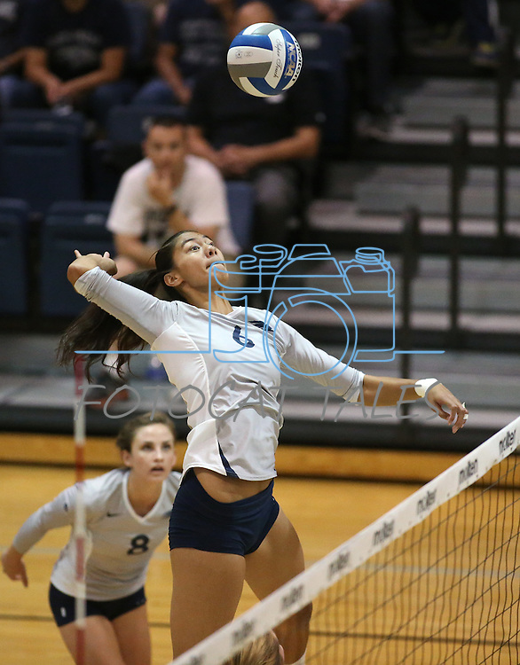 Nevada's Tessa Lea'ea hits against Air Force during college volleyball action in Reno, Nev., on Thursday, Sept. 25, 2014. Air Force won 3-2.<br /> Photo by Cathleen Allison
